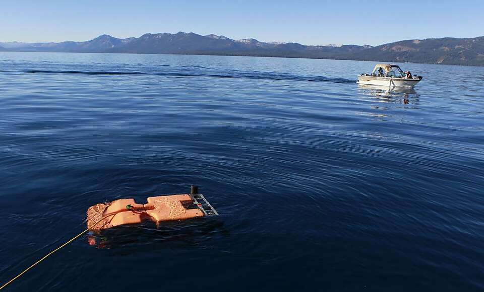 A submersible remotely operates vehicle floats on the surface of Lake Tahoe during a seismic study o