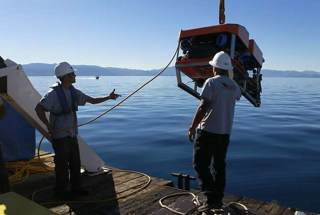 Researchers move a remotely operated submersible into position for a seismic study at the bottom of Lake Tahoe. Photo: Paul Chinn, The Chronicle