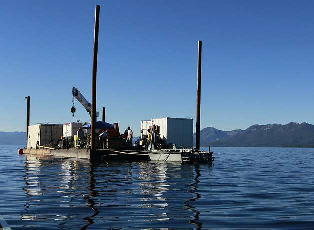 Researchers aboard a barge anchored two-and-a-half miles from shore conduct a seismic study at the bottom of Lake Tahoe near Tahoe City, Calif. on Wednesday, Aug. 29, 2012. Photo: Paul Chinn, The Chronicle