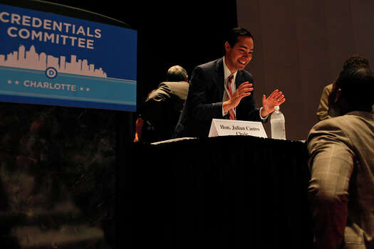 Mayor Julian Castro talks with Andrew Gilllum, Vice Mayor of Tallahassee, FL, who is friends with the Castro brothers, before a meeting of the Credentials Committee, which Castro is the co-chair of, at the Charlotte Convention Center in Charlotte, NC, for the Democratic National Convention on Sunday, Sept. 2, 2012. Photo: Lisa Krantz, San Antonio Express-News / San Antonio Express-News