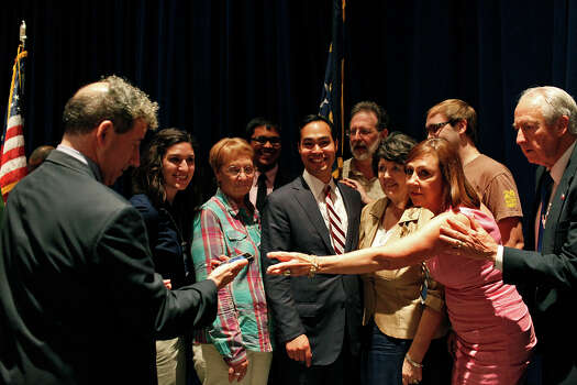 Mayor Julian Castro stands with the Texas delegates for the Credentials Committee, which he is the co-chair of, as they prepare for a group photo after a meeting of the committee at the Charlotte Convention Center in Charlotte, NC, for the Democratic National Convention on Sunday, Sept. 2, 2012. Photo: Lisa Krantz, San Antonio Express-News / San Antonio Express-News