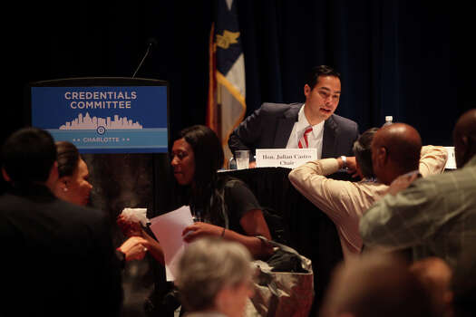 Mayor Julian Castro talks with Arturo Rodriguez, a San Antonio native and President of the United Farm Workers of America, before a meeting of the Credentials Committee, which Castro is the co-chair of, at the Charlotte Convention Center in Charlotte, NC, for the Democratic National Convention on Sunday, Sept. 2, 2012. Photo: Lisa Krantz, San Antonio Express-News / San Antonio Express-News