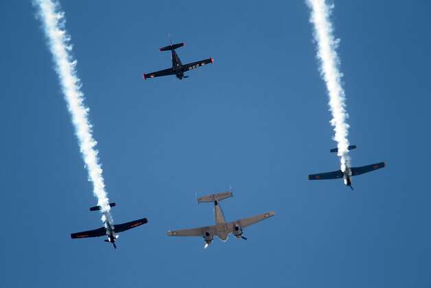 Planes fly overhead during a celebration for the Petaluma Nationals Little League team. Photo: Mathew Sumner, Special To The Chronicle