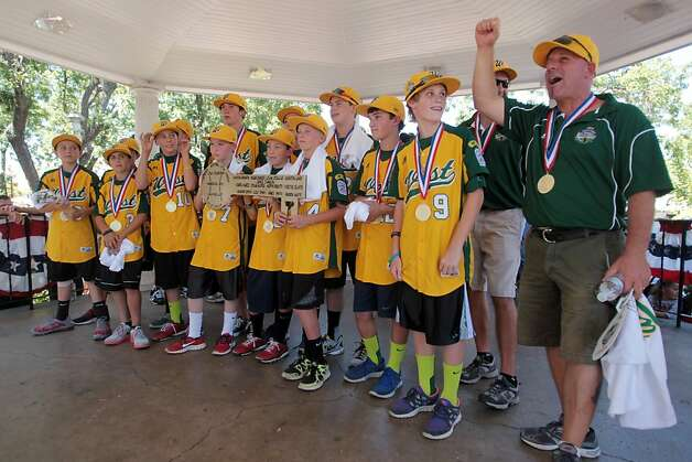 Petaluma Little League assistant coach Trevor Tomei celebrates with his team after their trip to the Little League World Series. Photo: Mathew Sumner, Special To The Chronicle