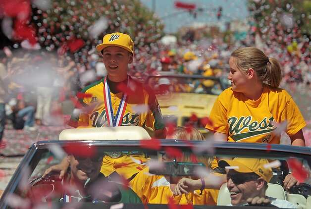 Petaluma Little League player Hance Smith rides in a parade celebrating the team's third place finish in the Little League World Series in Petaluma, Calif. on Sunday, September 2, 2012. Photo: Mathew Sumner, Special To The Chronicle