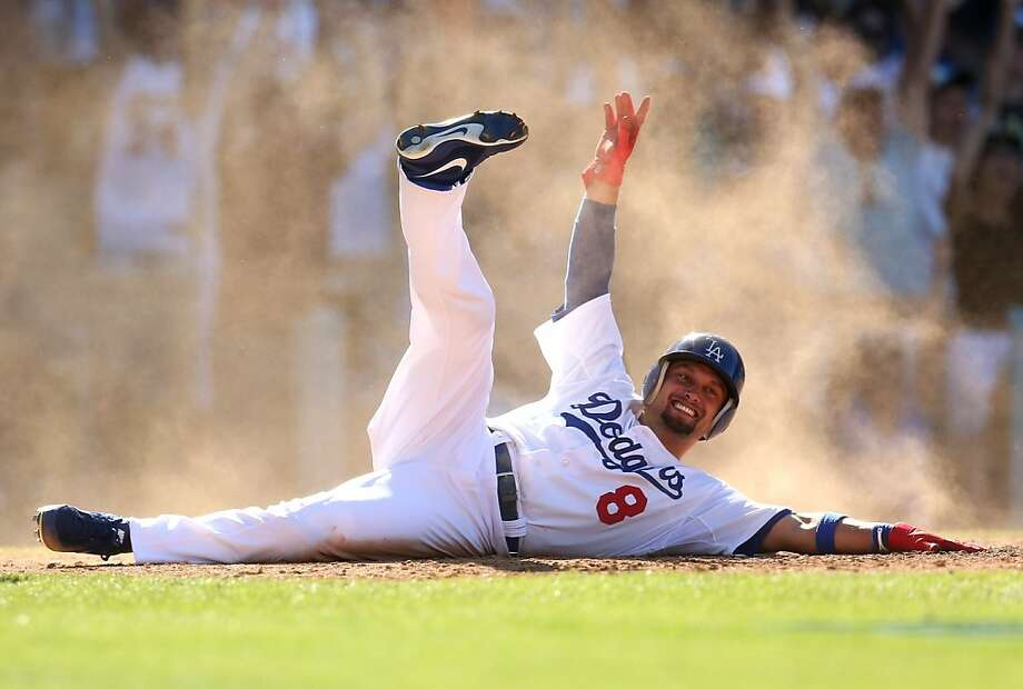 Adrian Gonzalez doubled in the tying and winning runs in the bottom of the ninth inning Sunday, giving Los Angeles a series split. Photo: Stephen Dunn, Getty Images