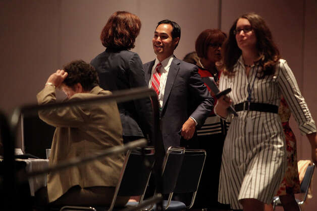 Mayor Julian Castro talks with North Carolina Treasurer Janet Cowell after a meeting of the Credentials Committee, which he is the co-chair of, at the Charlotte Convention Center in Charlotte, NC, for the Democratic National Convention on Sunday, Sept. 2, 2012. Cowell is vice-chair of the committee. Photo: Lisa Krantz, San Antonio Express-News / San Antonio Express-News