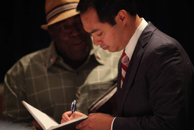 Mayor Julian Castro signs a book for a delegate at the conclusion of a meeting of the Credentials Committee, which he is the co-chair of, at the Charlotte Convention Center in Charlotte, NC, for the Democratic National Convention on Sunday, Sept. 2, 2012. Photo: Lisa Krantz, San Antonio Express-News / San Antonio Express-News