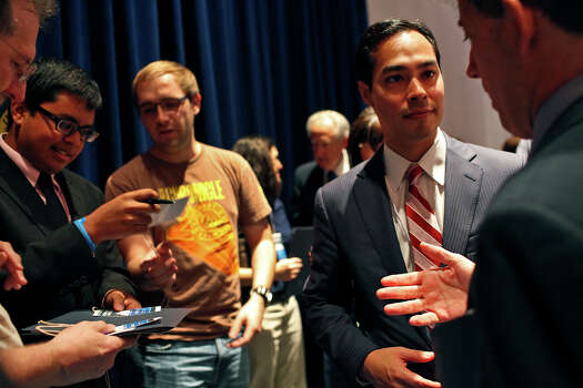 Mayor Julian Castro talks with Maryland State Senator Jamie Raskin, right, after a meeting of the Credentials Committee, which Castro is the co-chair of, at the Charlotte Convention Center in Charlotte, NC, for the Democratic National Convention on Sunday, Sept. 2, 2012. Photo: Lisa Krantz, San Antonio Express-News / San Antonio Express-News