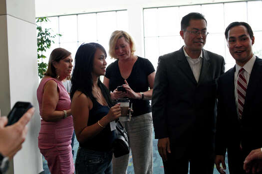 Mayor Julian Castro is inundated by delegates who want to talk with him, take photos and get his autograph after a meeting of the Credentials Committee, which he is the co-chair of, at the Charlotte Convention Center in Charlotte, NC, for the Democratic National Convention on Sunday, Sept. 2, 2012. Photo: Lisa Krantz, San Antonio Express-News / San Antonio Express-News