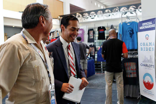 Mayor Julian Castro talks with Arturo Rodriguez, a San Antonio native and President of the United Farm Workers of America, left, as they walk to a meeting of the Credentials Committee, which Castro is the co-chair of, at the Charlotte Convention Center in Charlotte, NC, for the Democratic National Convention on Sunday, Sept. 2, 2012. Photo: Lisa Krantz, San Antonio Express-News / San Antonio Express-News