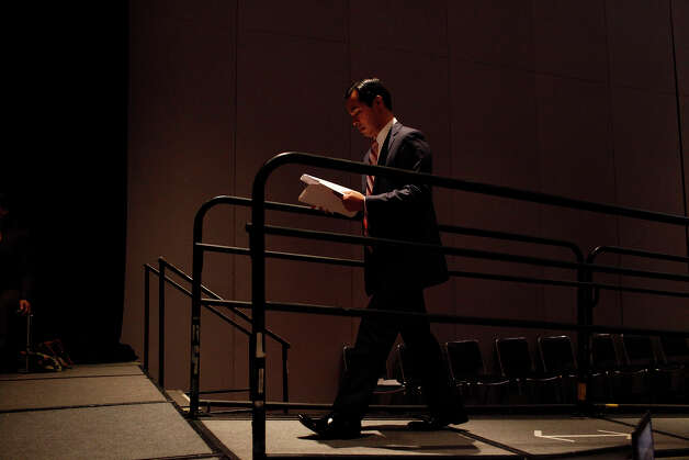 Mayor Julian Castro walks on a stage to lead a meeting of the Credentials Committee, which he is the co-chair of, at the Charlotte Convention Center in Charlotte, NC, for the Democratic National Convention on Sunday, Sept. 2, 2012. Photo: Lisa Krantz, San Antonio Express-News / San Antonio Express-News