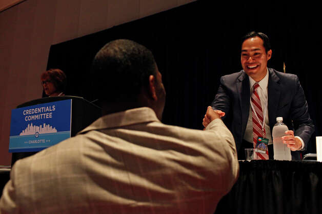 Mayor Julian Castro greets Andrew Gilllum, Vice Mayor of Tallahassee, FL, who is friends with the Castro brothers, before a meeting of the Credentials Committee, which Castro is the co-chair of, at the Charlotte Convention Center in Charlotte, NC, for the Democratic National Convention on Sunday, Sept. 2, 2012. Photo: Lisa Krantz, San Antonio Express-News / San Antonio Express-News