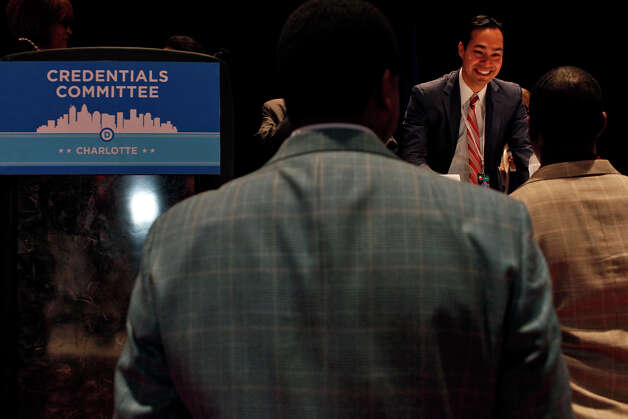 Mayor Julian Castro talks with Andrew Gilllum, right, Vice Mayor of Tallahassee, FL, who is friends with the Castro brothers, before a meeting of the Credentials Committee, which Castro is the co-chair of, at the Charlotte Convention Center in Charlotte, NC, for the Democratic National Convention on Sunday, Sept. 2, 2012. Photo: Lisa Krantz, San Antonio Express-News / San Antonio Express-News