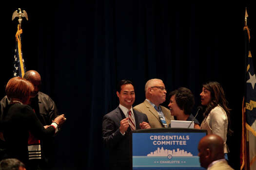 Mayor Julian Castro talks with leaders before a meeting of the Credentials Committee, which he is the co-chair of, at the Charlotte Convention Center in Charlotte, NC, for the Democratic National Convention on Sunday, Sept. 2, 2012. Photo: Lisa Krantz, San Antonio Express-News / San Antonio Express-News
