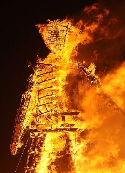 The Man burns on the playa at Burning Man on the Black Rock Desert near Gerlach, Nev. on Friday Augu