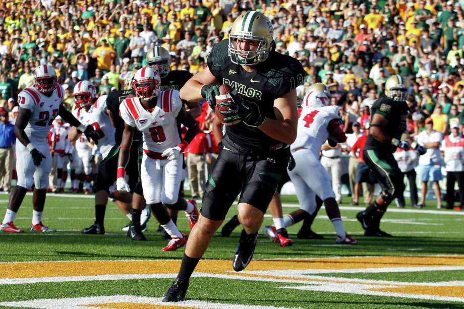Baylor tight end Jordan Najvar (18) pulls in a touchdown pass during the first half of an NCAA college football game against Southern Methodist in Waco, Texas, Sunday, Sept. 2, 2012. (AP Photo/LM Otero) Photo: LM Otero, Associated Press / AP