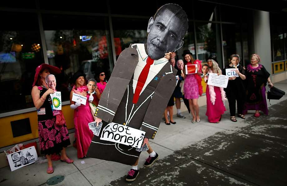 Code Pink protesters march in front of the NASCAR Hall of Fame before the start of the Democratic National Convention (DNC) September 2, 2012 in Charlotte, North Carolina. The Democratic National Convention is scheduled to start on Tuesday and run through September 6th.  (Photo by Tom Pennington/Getty Images) Photo: Tom Pennington, Getty Images