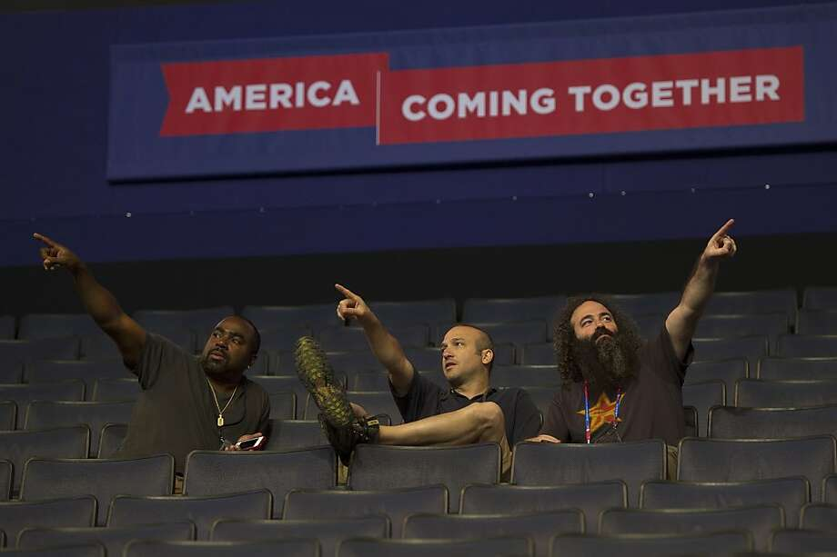 Sound technicians point to different speaker locations during set up prior to the Democratic National Convention in Charlotte, North Carolina, U.S., on Sunday, Sept. 2, 2012. Democrats gathering for their national convention framed this year's election as two competing economic plans rather than a referendum on President Barack Obama. Photographer: David Paul Morris/Bloomberg Photo: David Paul Morris, Bloomberg