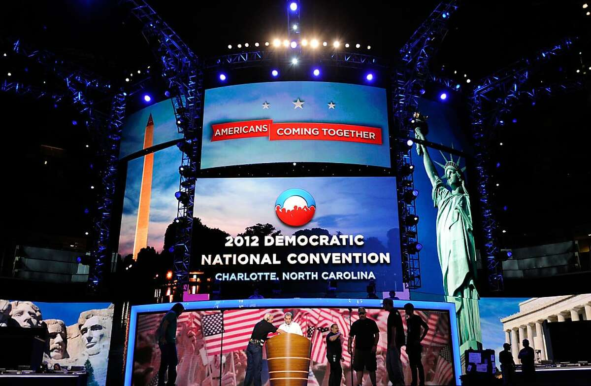 Workers stand on stage during preparations for the Democratic National Convention at Time Warner Cable Arena on September 2, 2012 in Charlotte, North Carolina. The DNC that will start on September 4 and run through September 7, will nominate U.S. President Barack Obama as the Democratic presidential candidate. (Photo by Kevork Djansezian/Getty Images)