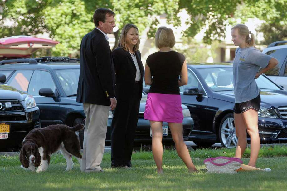 Union College President Stephen Ainlay and his wife Judith Ainlay and their dog Winston, visit with Susan Reardon from Dedham, MA and her daughter Annie Reardon during freshman move in day at Union College on Sunday, Sept. 2, 2012 in Schenectady, NY.  Annie is an incoming freshman.  The 592 first-year students were selected from among a record 5,565 applicants.  The freshman class has students from 2 states and 13 countries.   (Paul Buckowski / Times Union) Photo: Paul Buckowski
