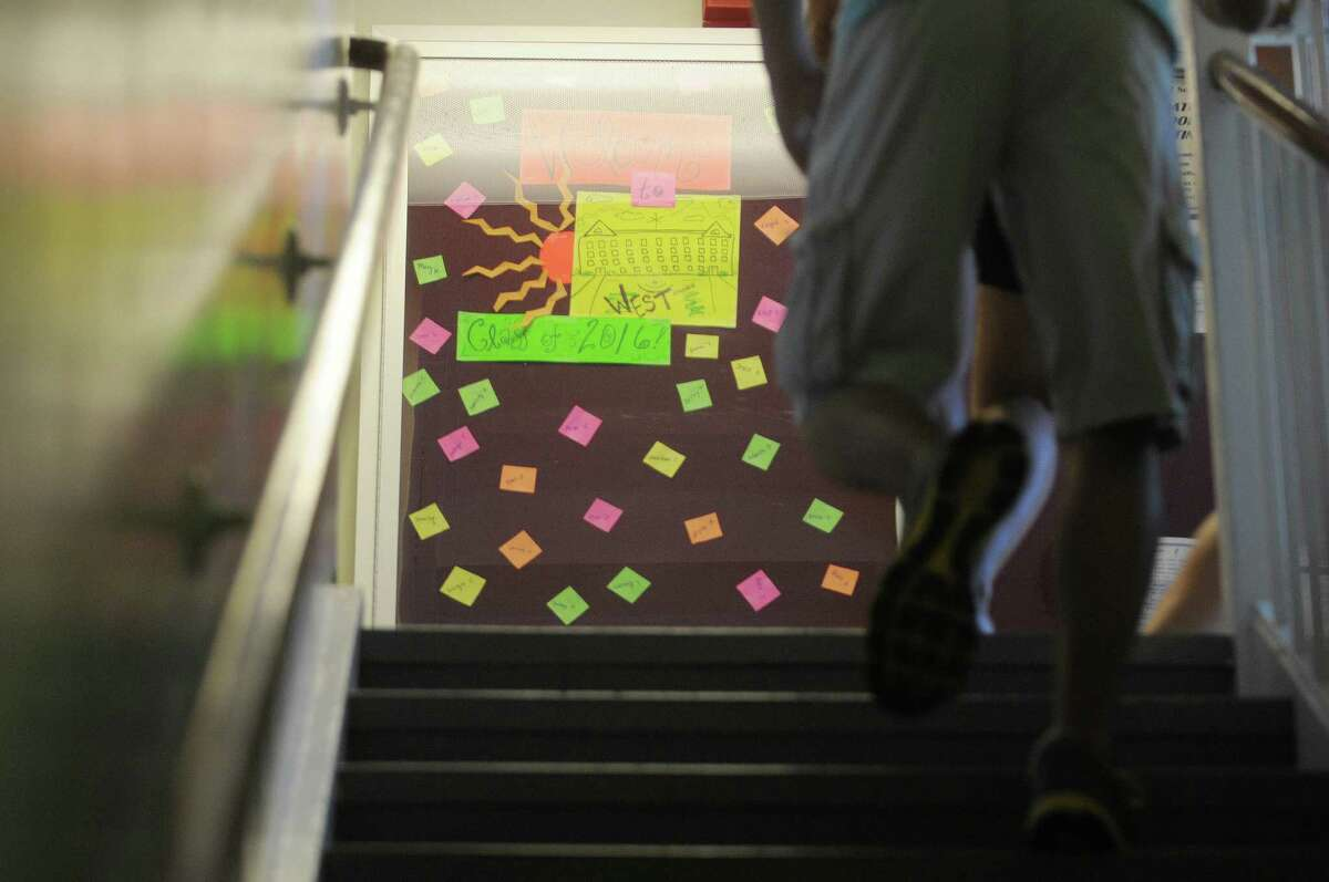 Welcoming messages are seen posted on the wall in a dorm during freshman move in day at Union College on Sunday, Sept. 2, 2012 in Schenectady, NY. The 592 first-year students were selected from among a record 5,565 applicants. The freshman class has students from 2 states and 13 countries. (Paul Buckowski / Times Union)