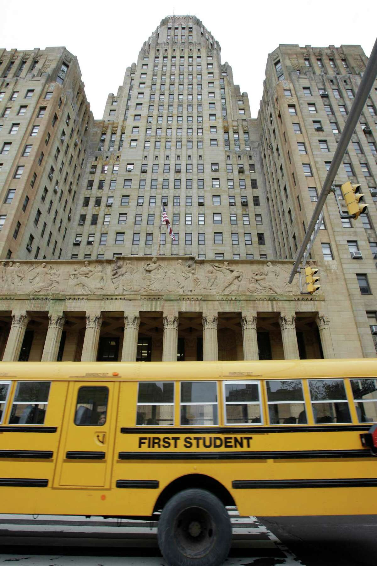 A school bus passes City Hall at a rally and Buffalo schools boycott Monday, May 16, 2011, in Buffalo, N.Y. Some parents in Buffalo kept their children out of class Monday and then gathered on the steps of City Hall to protest the city school system's low graduation rates and underperforming schools. (AP Photo/David Duprey)