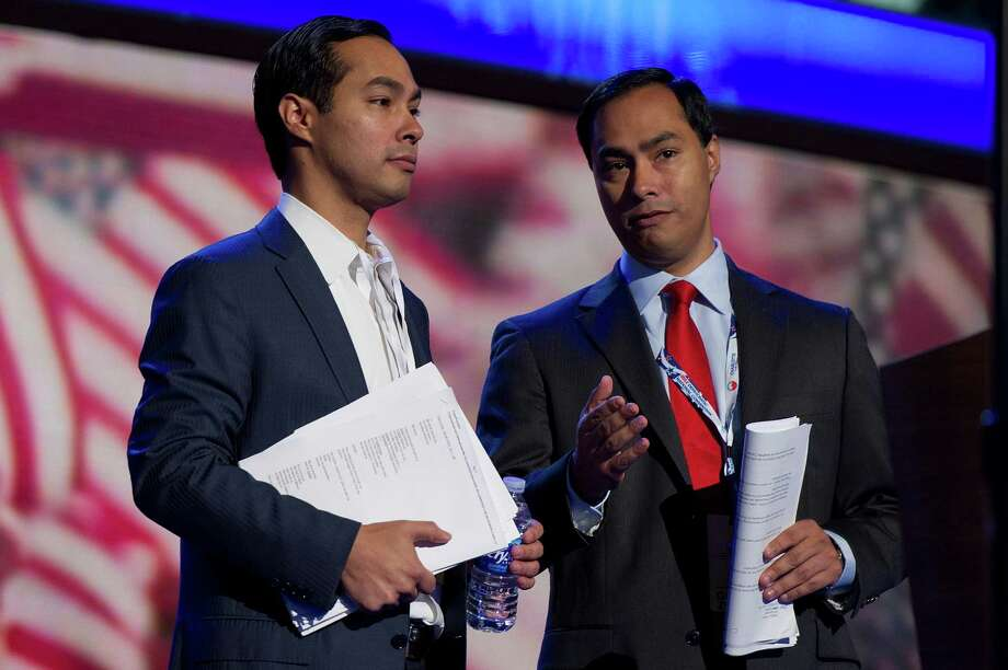 San Antonio mayor Julian Castro, left, and his brother, state Rep. Joaquin Castro, who is running for U.S. Congress, check out the stage prior to the Democratic National Convention in Charlotte, N.C. Photo: David Paul Morris / © 2012 Bloomberg Finance LP