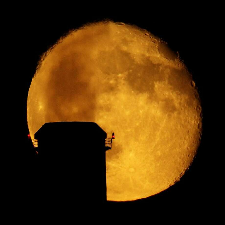 Emissions spewing from a smokestack at the La Cygne Power Plant are silhouetted against the rising moon Sunday, Sept. 2, 2012, in La Cygne, Kan. (AP Photo/Charlie Riedel) Photo: Charlie Riedel, Associated Press