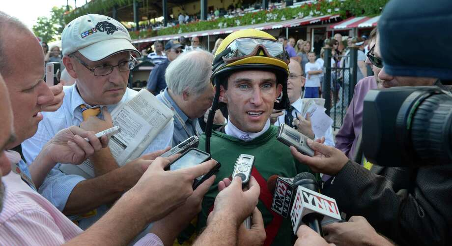 Jockey Ramon Dominguez is interviewed by media after he won his sixth race of the day at the Saratoga Race Course in Saratoga Springs, N.Y. Sept. 2, 2012.     (Skip Dickstein/Times Union) Photo: Skip Dickstein