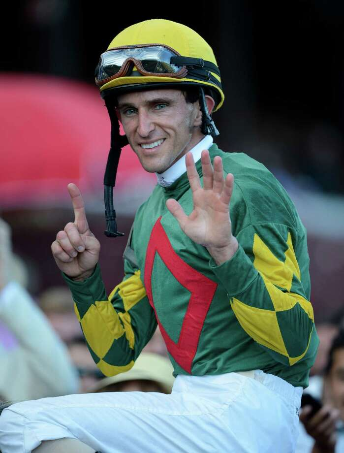Jockey Ramon Dominguez holds up six fingers after he won his sixth race of the day at the Saratoga Race Course in Saratoga Springs, N.Y. Sept. 2, 2012.     (Skip Dickstein/Times Union) Photo: Skip Dickstein