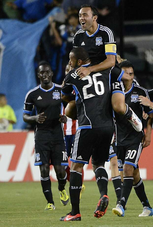 San Jose's Ramiro Corrales gets a lift from Victor Bernardez after scoring one of his two goals. Photo: Thearon W. Henderson, Getty Images