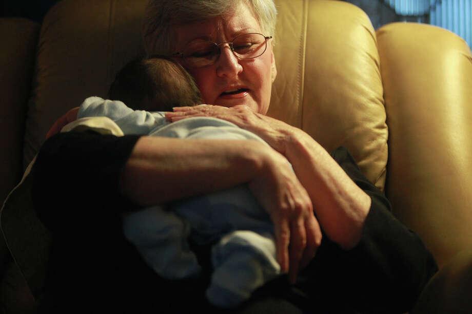 "SA Life - Foster parent LeClair Reaves holds ""Baby Alex"" at her home on Tuesday, Jan. 24, 2012. Lisa Krantz/San Antonio Express-News Photo: Lisa Krantz, San Antonio Express-News / @2012 SAN ANTONIO EXPRESS-NEWS"