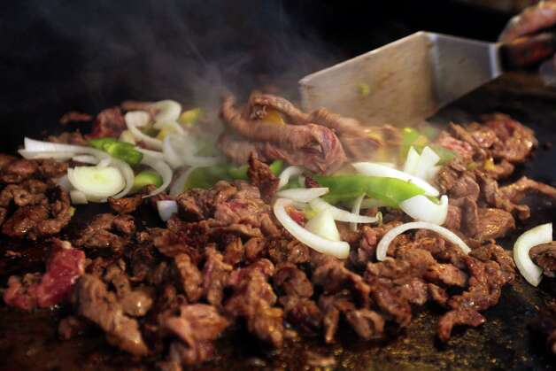 Fajita meat on the grill at Taco Taco San Antonio, September 1, 2012. (JENNIFER WHITNEY) Photo: JENNIFER WHITNEY, Special To The Express-News / © Jennifer Whitney