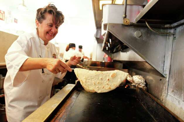Owner Helen Velesiotis finishes a fresh tortilla at Taco Taco San Antonio, Sept. 1, 2012. Photo: JENNIFER WHITNEY, Special To The Express-News / © Jennifer Whitney