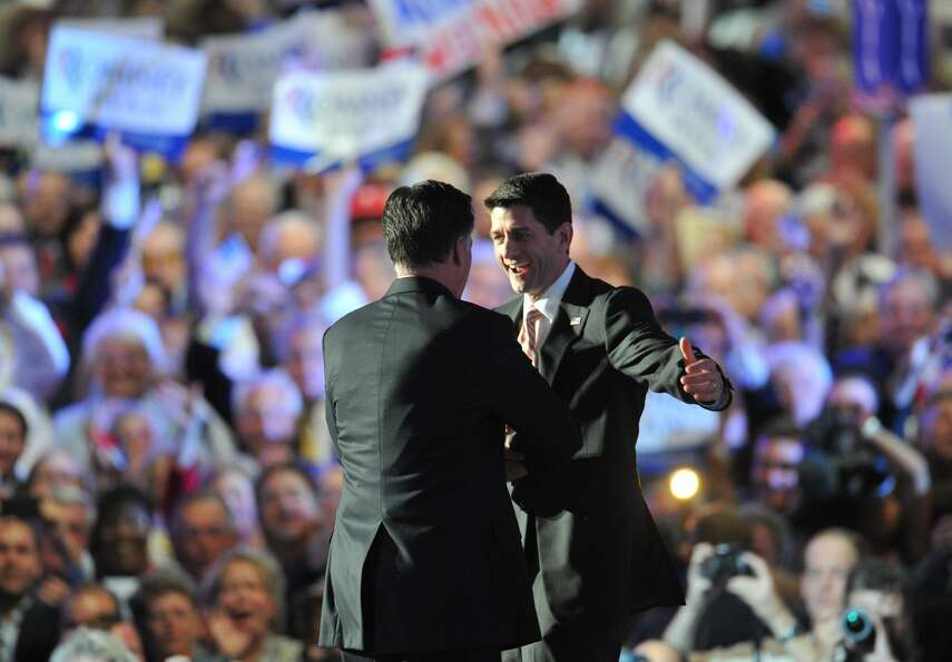 TOPSHOTS Republican presidential candidate Mitt Romney (R) and vice presidential nominee Paul Ryan h
