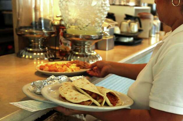 Breakfast tacos are served up on a busy Saturday morning at Taco Taco San Antonio, September 1, 2012. (JENNIFER WHITNEY) Photo: JENNIFER WHITNEY, Special To The Express-News / © Jennifer Whitney