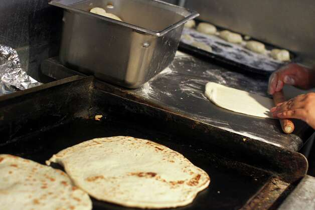 Fresh tortillas are rolled out before going on the grill at Taco Taco San Antonio, September 1, 2012. (JENNIFER WHITNEY) Photo: JENNIFER WHITNEY, Special To The Express-News / © Jennifer Whitney
