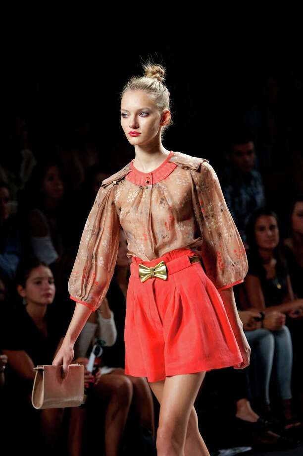 A model walks the runway in the Ailanto fashion show. Photo: Carlos Alvarez, Getty Images / 2012 Getty Images