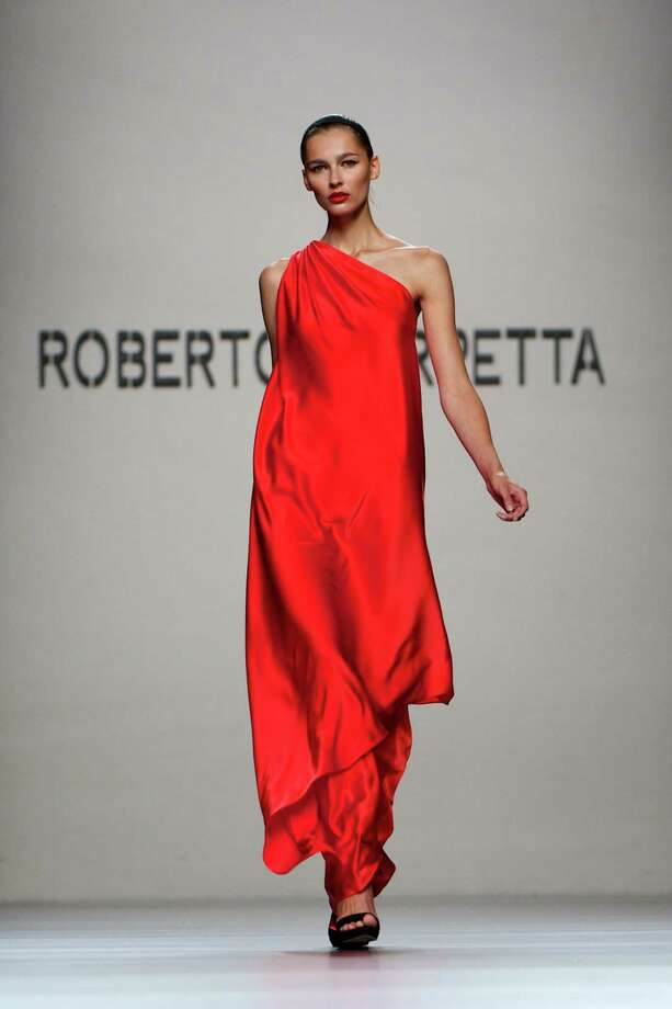 A model walks the runway in the Roberto Torretta fashion show. Photo: Carlos Alvarez, Getty Images / 2012 Getty Images
