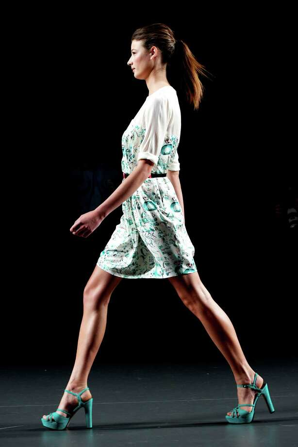 A model walks the runway in the Kina Fernandez fashion show. Photo: Carlos Alvarez, Getty Images / 2012 Getty Images