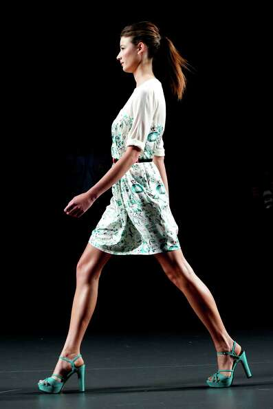 A model walks the runway in the Kina Fernandez fashion show.