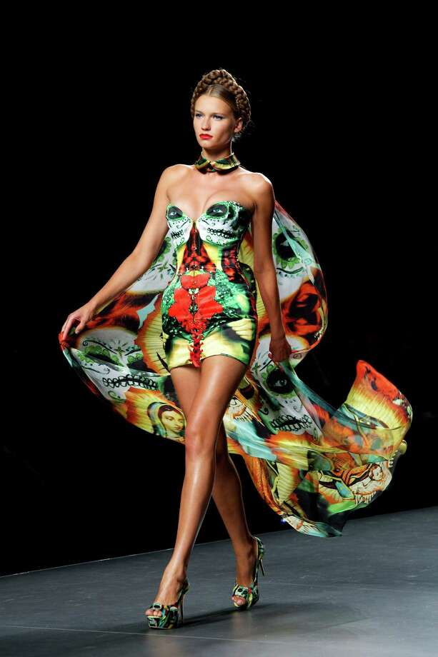 A model walks the runway in the Maya Hansen fashion show. Photo: Carlos Alvarez, Getty Images / 2012 Getty Images