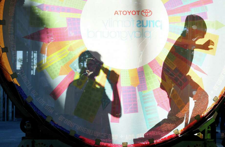 A young boy runs on a large wheel at the Prius Family Playground at Bumbershoot. Photo: LINDSEY WASSON / SEATTLEPI.COM