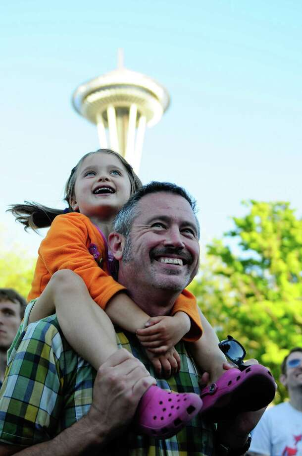 Stella Ledoux, 5, and her father Jeff smile as they listen to The Dirtbombs play at the TuneIn Fisher Green Stage at Bumbershoot. Photo: LINDSEY WASSON / SEATTLEPI.COM