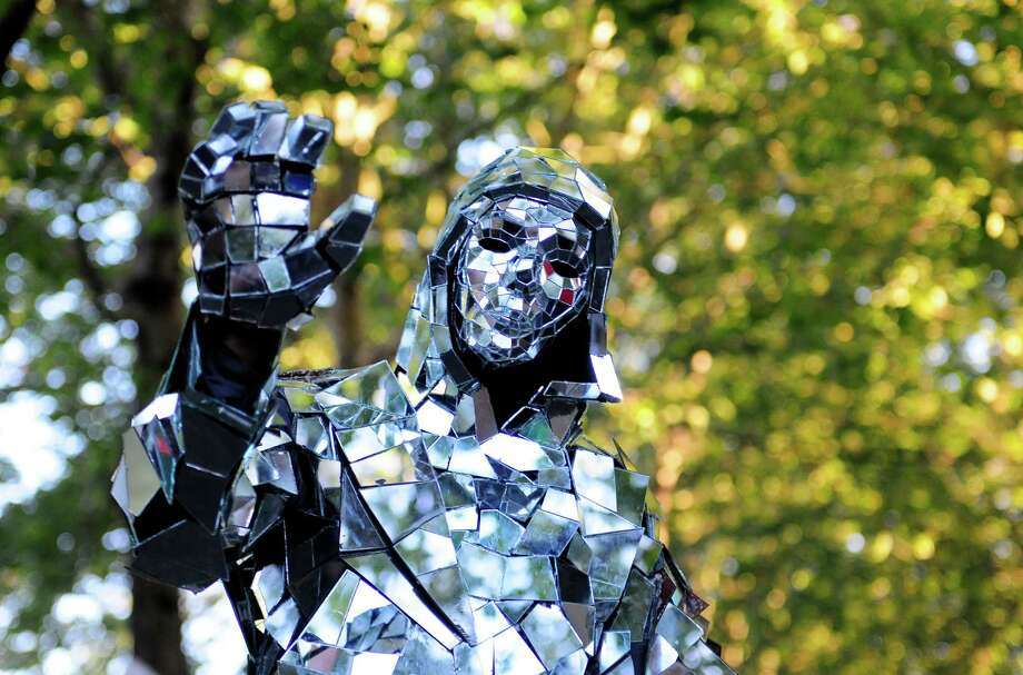 Mirror Man waves as spectators take his photograph at Bumbershoot on Sunday. Photo: LINDSEY WASSON / SEATTLEPI.COM