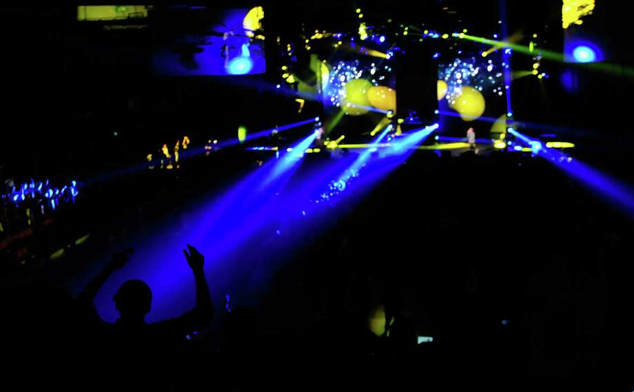 Artist Mac Miller provides a light show in KeyArena during Bumbershoot on Sunday. Photo: LINDSEY WASSON / SEATTLEPI.COM