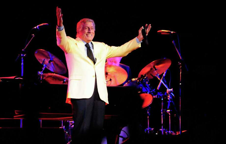 Tony Bennett raises his arms as he finishes a song at KeyArena during Bumbershoot on Sunday, September 2, 2012. Photo: LINDSEY WASSON / SEATTLEPI.COM