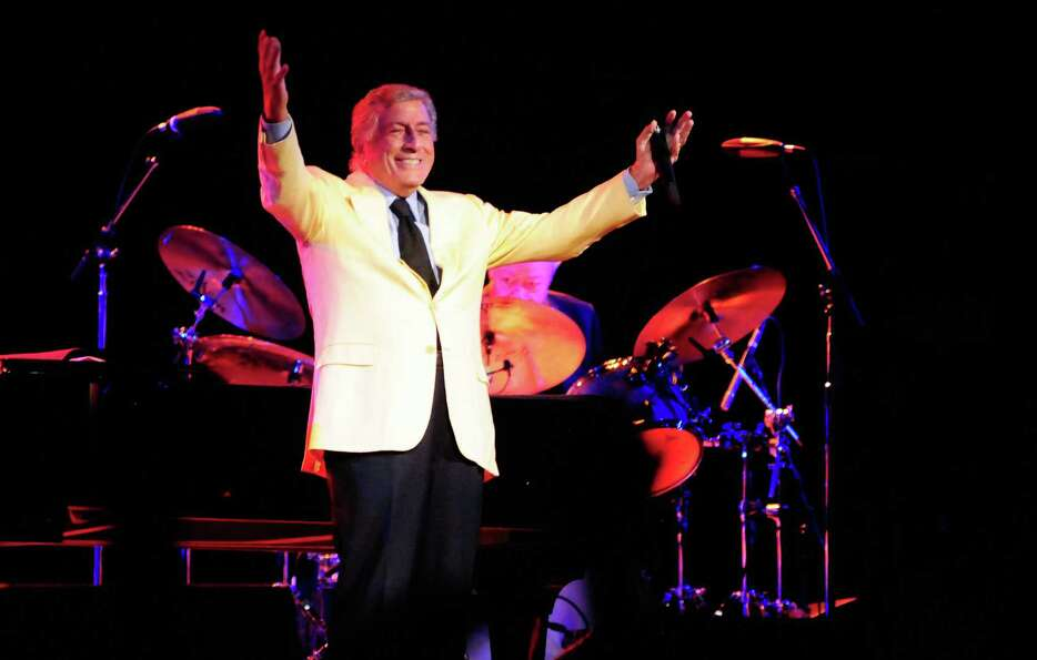 Tony Bennett raises his arms as he finishes a song at KeyArena during Bumbershoot on Sunday, Septemb