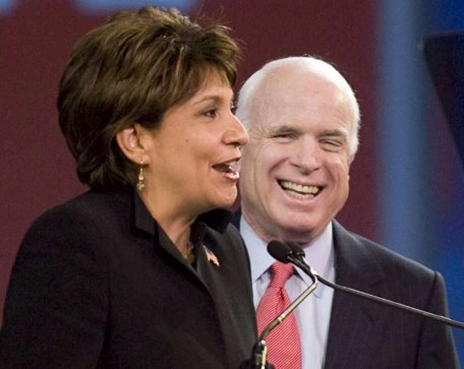 National Council of La Raza president Janet Murguia, left, speaks before Republican presidential candidate, Sen. John McCain, R-Ariz., right, gives his keynote address at the National Council of La Raza annual convention in San Diego, Calif., Monday, July 14, 2008.  (DENIS POROY / AP)